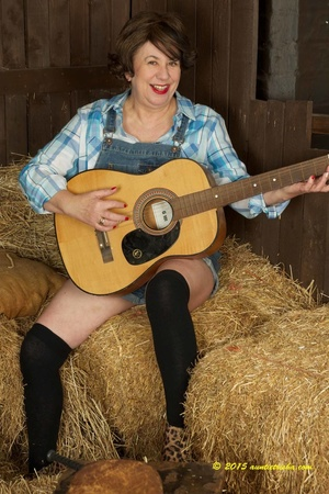 Old farm chick taked off her jumper then opens her blue and white checkered polo and bares her huge breasts and pussy wearing her black socks and leoapard skin designed high heels in a barn. - XXXonXXX - Pic 1