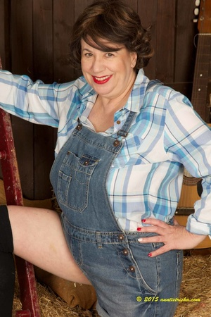 Old farm chick taked off her jumper then opens her blue and white checkered polo and bares her huge breasts and pussy wearing her black socks and leoapard skin designed high heels in a barn. - XXXonXXX - Pic 3
