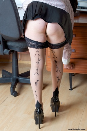 Mature secretary takes off her pink and white stripe polo and black skirt then displays her fat body in the office before she strips off her black, white and red underwear and bares her huge tits and hot pussy wearing her black, white and red corset and black high heels while sitting on her desk. - XXXonXXX - Pic 3
