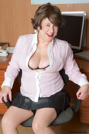 Mature secretary takes off her pink and white stripe polo and black skirt then displays her fat body in the office before she strips off her black, white and red underwear and bares her huge tits and hot pussy wearing her black, white and red corset and black high heels while sitting on her desk. - XXXonXXX - Pic 5
