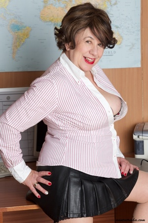 Mature secretary takes off her pink and white stripe polo and black skirt then displays her fat body in the office before she strips off her black, white and red underwear and bares her huge tits and hot pussy wearing her black, white and red corset and black high heels while sitting on her desk. - XXXonXXX - Pic 8