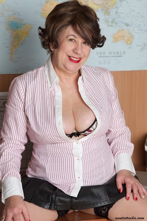 Mature secretary takes off her pink and white stripe polo and black skirt then displays her fat body in the office before she strips off her black, white and red underwear and bares her huge tits and hot pussy wearing her black, white and red corset and black high heels while sitting on her desk. - XXXonXXX - Pic 9