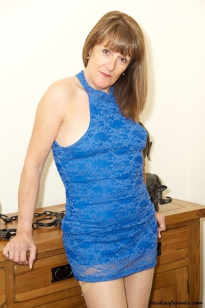 Hot cougar in blue dress and high heels slowly gets naked and displays her mature tits and butt by her wooden drawer. - XXXonXXX - Pic 5