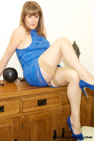 Hot cougar in blue dress and high heels slowly gets naked and displays her mature tits and butt by her wooden drawer. - XXXonXXX - Pic 11