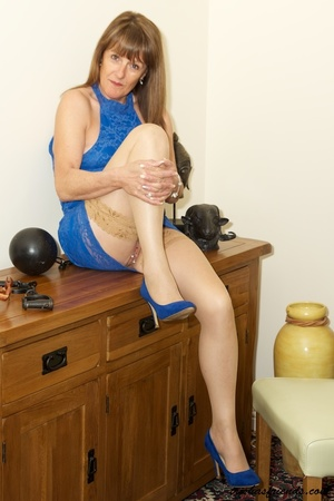 Hot cougar in blue dress and high heels slowly gets naked and displays her mature tits and butt by her wooden drawer. - XXXonXXX - Pic 12