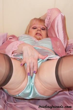 Mature MILF opens her pink robe then rubs her pussy wearing her turquoise lingerie, high heels and black stockings before she expose her big breasts on a pink bed. - XXXonXXX - Pic 5