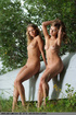 Fillies pose in the nude on a white upturned boat.