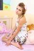 Lovely teen babe pulls down her white nighty with…