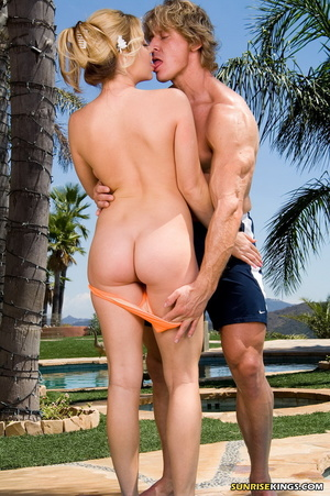 Cute dame in a peach bandeau bikini gets busy with a guy by the pool. - XXXonXXX - Pic 6