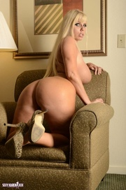 luscious blonde sits small