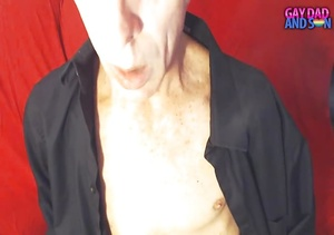 Old dude lays down and smokes a cigarette on a red bed wearing a black robe before he pulls his big cock out of his red and black brief. - XXXonXXX - Pic 1