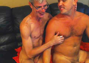 Mature dude with glasses wearing white shirt and a hot stud in green shirt both get naked then eats each others dicks in sixty-nine positions on a blue leather couch. - XXXonXXX - Pic 2