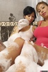 Gorgeous chick in white shirt takes a bubble bath with a lusty chick in