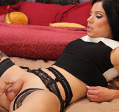 She-male in black lingerie gets some power vibe treatment form a brunette