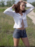 Angelic doe in a white blouse and denim shorts…