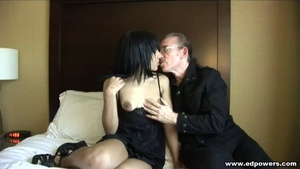 Skinny chick in black nighty makes out with an old dude then gets naked and rubs her pussy before she lets him lick it on a white bed then she sucks his cock before she lets him fuck her in missionary and doggy positions. - XXXonXXX - Pic 1