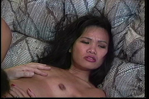 Filipina hottie sits on a gray couch wearing her green and brown shirt, black leggings and white rubber shoes then talks about doing some nude modelling. - XXXonXXX - Pic 4