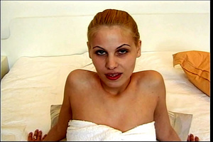 Blonde chick gets on a white bed and takes off her white towel then bares her skinny body with petite boobs before she lets the camera man fingers her pussy then she rubs it on camera. - XXXonXXX - Pic 1