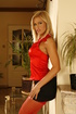 Blonde with tight boobs bending her slender legs…