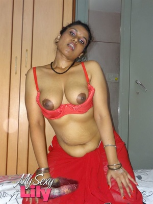 Stunning Indian chick displays her hot curves in red and black dress before she pulls it down and bares her hot tits with big nipples under her red bra on a gray and white bed. - XXXonXXX - Pic 8