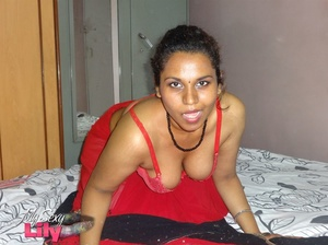 Stunning Indian chick displays her hot curves in red and black dress before she pulls it down and bares her hot tits with big nipples under her red bra on a gray and white bed. - XXXonXXX - Pic 11