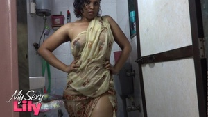 Indian hottie wraps herself with her white and brown shawl then gets her body wet as she takes a shower before she reveals her luscious soft breasts in the bathroom. - XXXonXXX - Pic 3