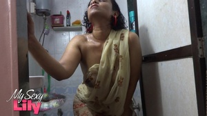 Indian hottie wraps herself with her white and brown shawl then gets her body wet as she takes a shower before she reveals her luscious soft breasts in the bathroom. - XXXonXXX - Pic 5