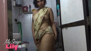 Indian hottie wraps herself with her white and brown shawl then gets her body wet as she takes a shower before she reveals her luscious soft breasts in the bathroom. - XXXonXXX - Pic 7