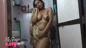 Indian hottie wraps herself with her white and brown shawl then gets her body wet as she takes a shower before she reveals her luscious soft breasts in the bathroom. - XXXonXXX - Pic 10