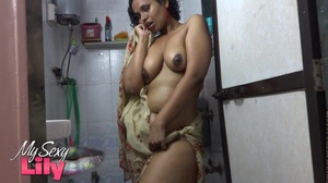 Indian hottie wraps herself with her white and brown shawl then gets her body wet as she takes a shower before she reveals her luscious soft breasts in the bathroom. - XXXonXXX - Pic 11