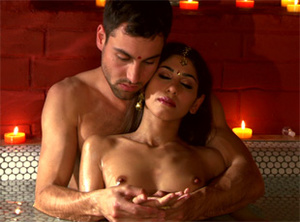 Swarthy Indian babe with natural tits gets high from oil massage performed by a brunette - XXXonXXX - Pic 1
