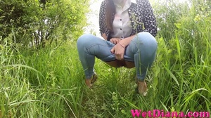 Drinking beer provokes hottie to pee on the green grass - XXXonXXX - Pic 1