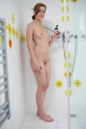 Teen chick shows her hot curves with juicy tits and pussy as she gets in the shower naked then gets wet as she takes a cold bath. - XXXonXXX - Pic 5