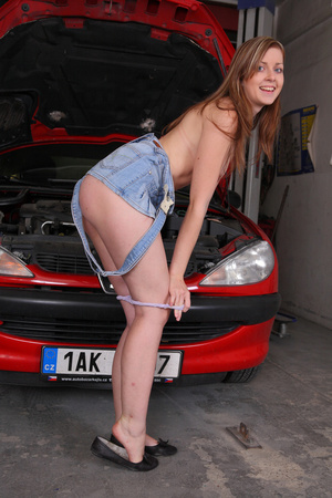 Teen mechanic displays her small luscious tits wearing wearing her blue jumper,skirt, purple panty and black shoes while fixing a red car in a gagrage. - XXXonXXX - Pic 14
