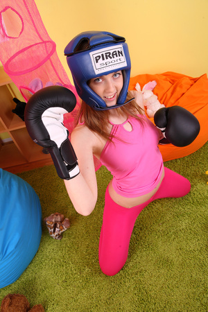 Teen hottie wearing blue head gear and black boxing gloves displays her hot body in sexy pink shirt and leggings before she slowly gets naked on an orange bean bag then reveals her small tits and indulging pussy. - XXXonXXX - Pic 6
