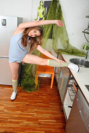 Smoking hot chick eating a slice of orange while she pose her sexy body in hot blue dress then she strips it off, sticks a big red dildo on the kitchen cabinet and sucks it hard wearing her blue panty, green socks and white rubber shoes. - XXXonXXX - Pic 4