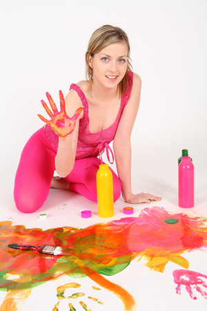 Lovely young babe pose her hot curves wearing tight pink shirt and leggings then rolls over the floor and fills her smoking hot body with different colored paints. - XXXonXXX - Pic 4