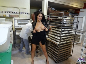 Cute bitch in a black dress and coat bares all at a bakery. - XXXonXXX - Pic 1