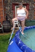 Gorgeous granny gets her big body wet in a pool wearing her white shirt