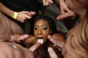 Beautiful ebony gets surrounded by huge dicks then sucks them and gets fucked in doggy position on a white bed. - XXXonXXX - Pic 1