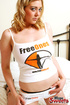 Awesome fawn in a FreeOnes shirt and black thong bares it all in the bedroom.