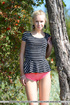 Fascinating diva takes off her striped top, pink…