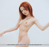 Wicked red-haired lady shows off her trimmed V on some white stairs.