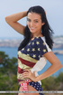 Captivating vamp in a stars and stripes shirt and…