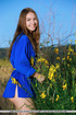Incredible gal takes off her blue robe by a bush…