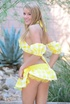 Lovely blonde in sexy yellow and white bikini takes them off piece by