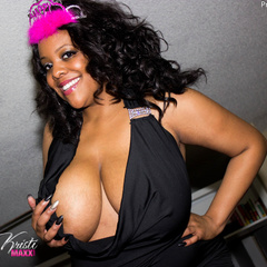 Busty ebony pops her monster boobs out of her black - Picture 2