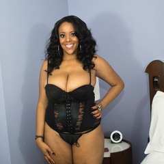 Luscious ebony teasing as she pose in her black lingerie - Picture 1