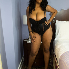 Luscious ebony teasing as she pose in her black lingerie - Picture 2
