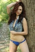 Gorgeous brunette with stunning body opens her jeans jacket and shows